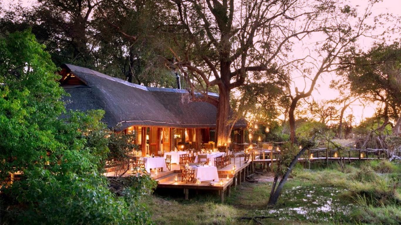 lantern lit dinner at andbeyond nxabega on a botswana safari 950x0