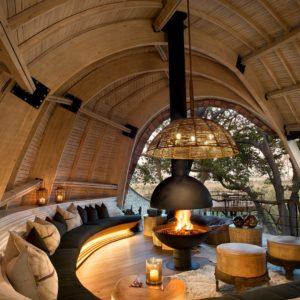 Header-cosy-fireplace-at-andBeyond-sandibe-on-a-luxury-botswana-safari-overlooking-the-okavango-delta